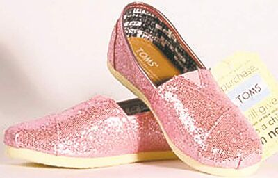 Glimmering pink flats jazz up any outfit.