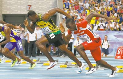 Matt Dunham / the associated pressUsain Bolt (left) and Trinidad and Tobago�s Rondel Sorrillo blast from the blocks in a 100-metre heat at the World Athletics Championships.