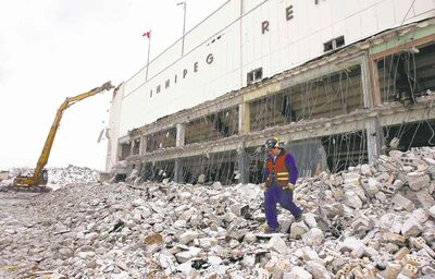 Demolition of the old Winnipeg Arena underway in 2005, with the W, along with other letters, already off the front of the building.