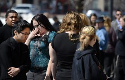 Mourners depart a memorial service for Nathan Leon at Flatirons Community Church in Lafayette, Colo. on Wednesday, March 27, 2013. About 300 friends and family members filled the church to honor the 27-year-old father of three who was found shot to death March 17. His killing may be linked to the murder two days later of Colorado prison chief Tom Clements. (AP Photo/The Denver Post, Craig F. Walker) MAGS OUT; TV OUT; INTERNET OUT; NO SALES