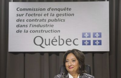 Justice France Charbonneau smiles as she sits on the opening day of a Quebec inquiry looking into allegations of corruption in the province's construction industry in Montreal, Tuesday, May 22, 2012.In the time it took Quebec's corruption inquiry to complete its fall sitting, three long-standing mayors had resigned, municipal parties were decimated or disbanded, and a shadow of suspicion spread over the political world. THE CANADIAN PRESS/Graham Hughes