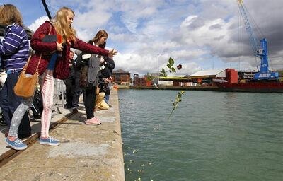 Various descendants of victims of the Titanic disaster cast roses into the dock at Southampton, England, from where the ill-fated luxury passenger liner sailed 100-years ago today, Tuesday April 10, 2012. More than 650 descendants of the Titanic passengers gathered for a ceremony at the same berth on the city's docks where the Titanic set sail on April 10, 1912, eventually with the lose of more than 1,500 people.(AP Photo / Chris Ison, PA) UNITED KINGDOM OUT - NO SALES - NO ARCHIVES