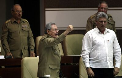 "Cuba's President Raul Castro, center left, with a raised fist shouts, ""Long live Fidel, long live the combative spirit of Fidel, long live the Revolution,"" accompanied by Vice President Miguel Diaz-Canel, right, Army Corps Gen. Alvaro Lopez Miera, back right, and Cuban Armed Forces Minister Leopoldo Cintras Frias, at the close of the of a twice-annual legislative sessions, at the National Assembly in Havana, Cuba, Saturday, Dec. 21, 2013. (AP Photo/Cubadebate, Ismael Francisco)"