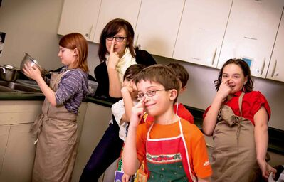 Tanya Marinelli has fun with her students at their last cooking class. The next session runs from Nov. 18 to Dec. 16.