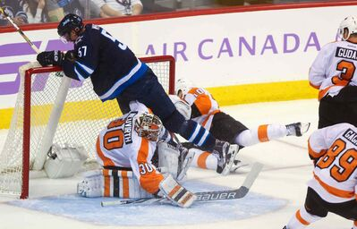 Winnipeg Jet Tyler Myers runs into the net in a game against the Philadelphia Flyers at the MTS Centre.