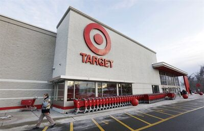 A passer-by walks near an entrance to a Target retail store Thursday, Dec. 19, 2013 in Watertown, Mass. THE CANADIAN PRESS/AP, Steven Senne