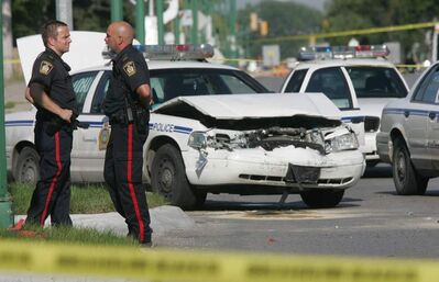 Officers attend the aftermath of a 2007 high-speed chase and crash, on which the case centres.