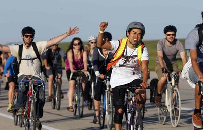 The 2014 Winnipeg Folk Fest began as hundreds of participants rode their bikes to Birds Hill Park to get priority entry to the five-day event and secure a camping spot.