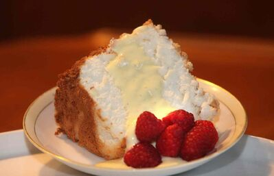 Vanilla angel food cake with crème anglaise.