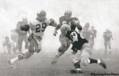 The Grey Cup game has a memorable background, including some humourous and controversial events over the years. The 1962 Grey Cup game, known as the Fog Bowl, had to be played over two days because of zero visibility.  Winnipeg Blue Bombers Leo Lewis (29) runs the ball as Hamilton Tiger Cats John Barrow (61) and Tim Reid (24) go in for the tackle.  That year, Winnipeg Blue Bombers defeated Hamilton Tiger-Cats 28-27.   (The Canadian Press Archives)
