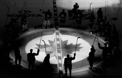 Jonathan Hayward / The Canadian Press archivesWinnipeg Jets players raise their sticks as they are introduced to the crowd prior to their inaugural game against the Montreal Canadiens at the MTS Centre on Oct. 9.