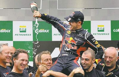 andre penner / the associated pressSebastian Vettel celebrates his sixth-place finish in Brazil, enough to clinch the 2012 F1 title.