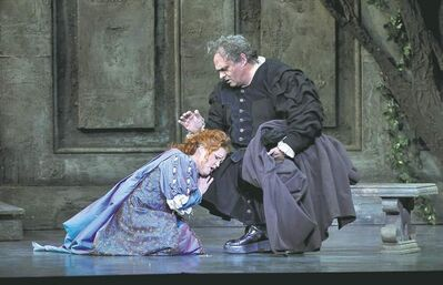 Rigoletto (Todd Thomas) consoles his daughter Gilda (Tracy Dahl) during rehearsal of Verdi's Rigoletto.