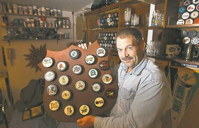 Lyle Rankin collects pucks from different leagues and eras.