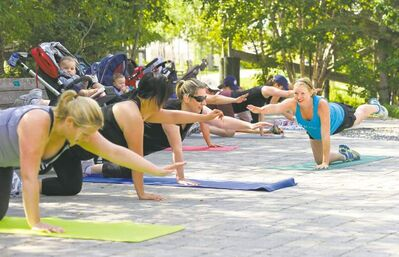 Aileen Hunt, at nine months pregnant, teaches an exercise class to pregnant women last August.