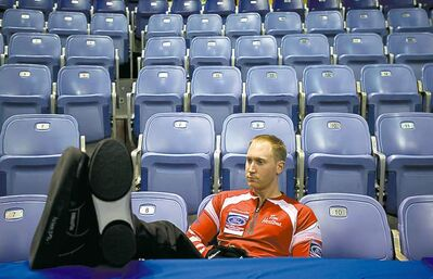 Team Canada skip Brad Jacobs kicks back during a practice session Friday.