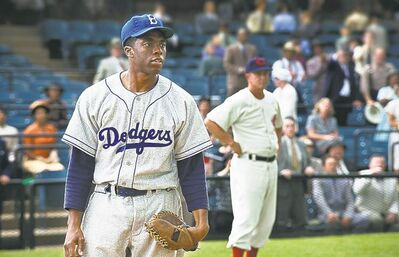 "This film image released by Warner Bros. Pictures shows Chadwick Boseman as Jackie Robinson in a scene from ""42."" The movie, about Robinson��s, life, is bringing his inspiring story to a new generation. Fans young and old can find a number of places in Brooklyn connected to the baseball great. (AP Photo/Warner Bros. Pictures, D. Stevens)"
