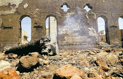 The smoldering ruins of the Evangelical Church of Malawi are seen after it was ransacked, looted and burned on Thursday by an angry mob, in Malawi, south of Minya, Egypt.