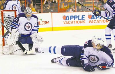 Jets goalie Ondrej Pavelec doesn't mind the shot-blocking help of defencemen such as Jacob Trouba, even if it means the odd deflection ends up in the net.