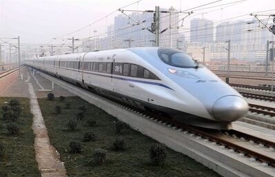 In this photo released by China's Xinhua news agency, a high-speed train G802 leaves for Beijing from Shijiazhuang, capital of north China's Hebei Province, Wednesday, Dec. 26, 2012. China has opened the world's longest high-speed rail line, which runs 2,298 kilometers (1,428 miles) from the country's capital in the north to Guangzhou, an economic hub in the Pearl River delta in southern China. (AP Photo/Xinhua, Wang Xiao) NO SALES