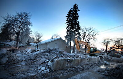 A frosty pile of rubble is all that remains at Havelock Avenue and St. Mary's Road after a New Year's Day fire. A family of six escaped unhurt.