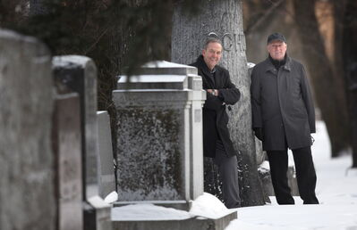 Wayne Rogers (left) and Jim Baker of the Friends of Historic Elmwood Cemetery.