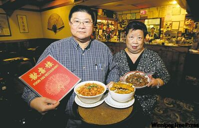 Stanley and Man Yuk Dare with some of their popular dishes, (from left) diced chicken Szechuan noodle soup, deep fried ribs noodle soup and Shanghai chow mein.