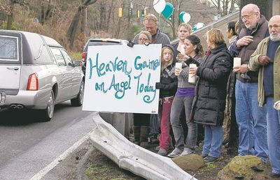 Craig Ruttle / The Associated PressMourners at a funeral procession for James Mattioli, 6, in Darien, Conn., Tuesday.