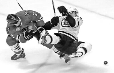 Boston's Daniel Paille takes a tumble after colliding with Chicago's Brent Seabrook during the third period of Game 1 Wednesday night.