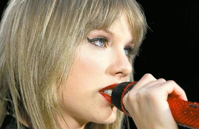 Red is the tour and red was the colour for Taylor Swift at a sold-out Investors Group Field on Saturday.