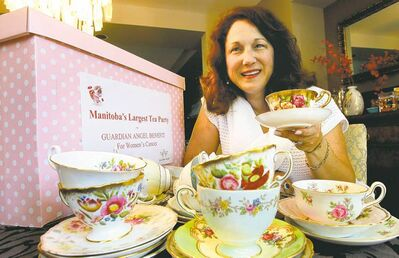 Sandra Lorange, who came up with the idea for the tea party, shows some of the teacups she's already collected.