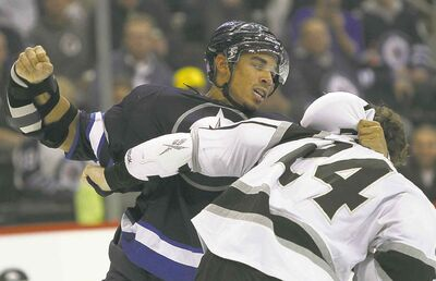 Winnipeg's Evander Kane hammers on L.A's Colin Fraser during second-period fisticuffs.