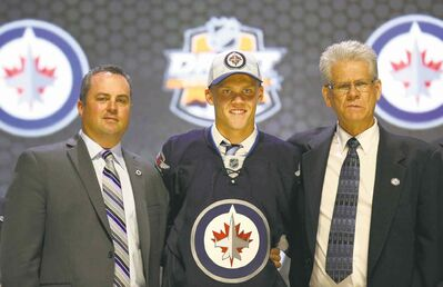 Bill Streicher / USA TODAY Sports Danish left-winger Nikolaj Ehlers with scouts Marc Hillier (left) and Marcel Comeau after going No. 9 overall to the Winnipeg Jets Friday night at the Wells Fargo Center.