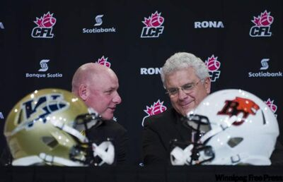 Winnipeg Blue Bombers coach Paul LaPolice (L) and B.C. Lions coach Wally Buono talk on Wednesday before a press conference in Vancouver in preparation for this weekend's 2011 Grey Cup.