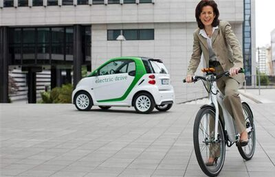 Annette Winkler, head of Daimler's Smart brand, rides the all-new Smart E-Bike, slated for arrival in Canada next year.