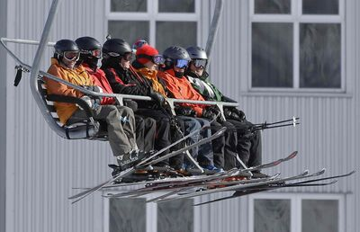 Skiers on a lift at Park City Mountain Resort, in Park City, Utah.