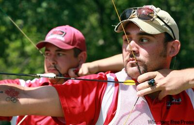 Winnipeg Olympian Jay Lyon (front) came up big in his last match — firing a 59-out-of-60 — to make the final eight in New Delhi.