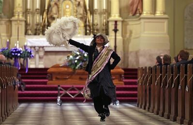 Performer Jennifer Jones dances at the conclusion of a funeral Mass for artist George Rodrigue, in New Orleans, Thursday, Dec. 19, 2013. THE CANADIAN PRESS/AP, Gerald Herbert