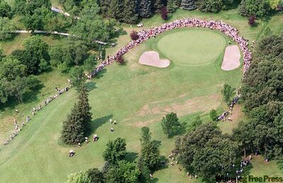 Hundreds of Winnipeg golf fans surround the fourth hole at St. Charles to see Jack Nicklaus and other top seniors in 2000.