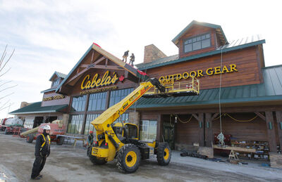 Finishing touches are added to the exterior of Cabela's new location at Season's of Tuxedo retail centre.