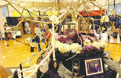 Tree Of Life features photos of missing women brought by family members. The tree is adorned with flowers and aboriginal medicines. It is at Thunderbird House.
