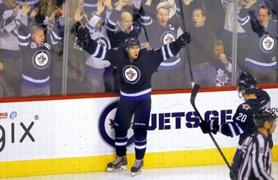 Evander Kane, and the 15,004 fans in attendance, celebrate his goal to put the Jets up 4-1.