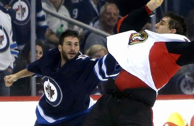 Winnipeg Jets Anthony Peluso (left) has been suspended for three games by the NHL.