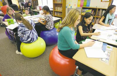 Students in Robbi Giuliano's fifth grade class sit on yoga balls at Westtown-Thornbury Elementary School in West Chester, Pa.