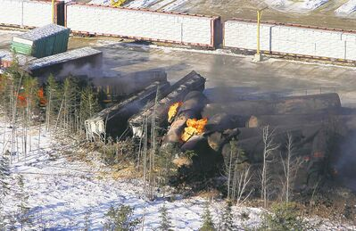 Train cars burn in Plaster Rock, N.B., Wednesday after a derailment Tuesday.