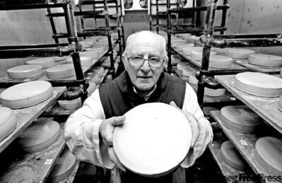 Brother Alberic with a wheel of Trappist cheese from the monastery at Holland.