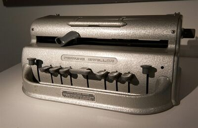 "In this Aug. 22, 2013, photo provided by Northeastern University, Italian opera tenor Andrea Bocelli's Standard Perkins Brailler typewriter sits on display in an exhibit called ""Celebrity Type."" Typewriters that belonged to notable 20th century people, including Tennessee Williams, Ernest Hemingway, John Lennon, Jack Kevorkian, and ""Unabomber"" Theodore Kaczynski are in the exhibit. (AP Photo/Northeastern University, Brooks Canaday)"