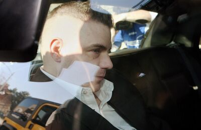 Michael Rafferty is transported from the courthouse in the back of police cruiser in London, Ont., on March, 14, 2012. The man convicted in the kidnapping and murder of eight-year-old Tori Stafford is to appear by video today at Ontario's highest court as part of an attempt to appeal his conviction. THE CANADIAN PRESS/Dave Chidley