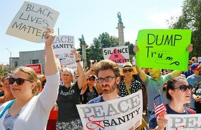 "Protesters listen during a ""Peace and Sanity"" rally Sunday Aug. 13, 2017, in New York, as speakers address white supremacy violence in Charlottesville, Va., yesterday. (AP Photo/Bebeto Matthews)"