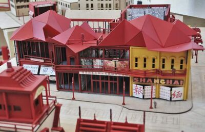 Tiffany Leong's Chinatown incorporates traditional second-storey apartments above street-level shops.